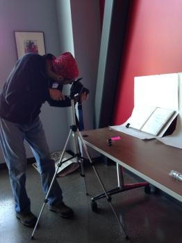 Census Volunteer, Darin Bauer photographing a 2013 Sketchbook